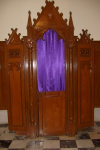 A confessional. Via Wikimedia Commons.