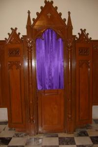 A confessional. Via Wikimedia Commons.